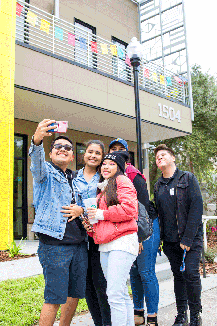 Students taking selfie at La Casita